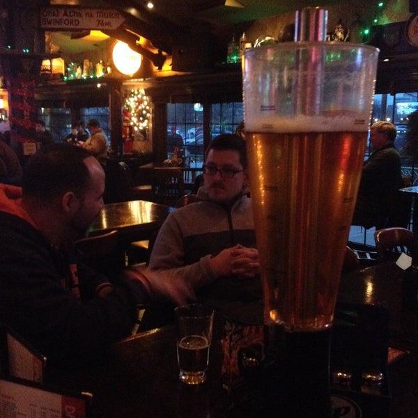 Photo taken at Finn McCool's Irish Sports Pub by ANDREW H. on 12/19/2014