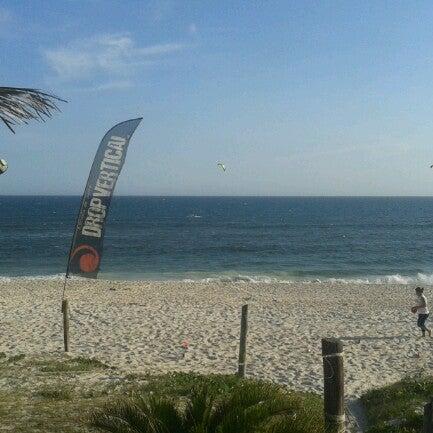 Photo taken at Praia da Barra da Tijuca by Wagner R. on 12/5/2012