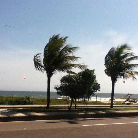 Photo taken at Praia da Barra da Tijuca by Rafa W. on 12/4/2012