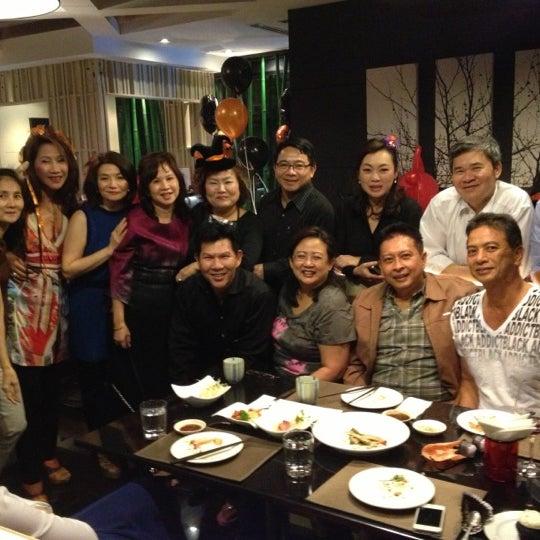 Photo taken at YASASHII Japanese Fusion Cuisine by Chiranuj B. on 10/31/2012