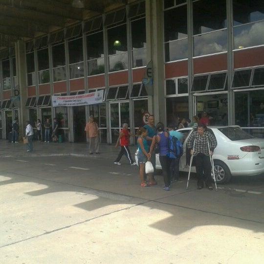 Photo taken at Terminal Rodoviário Governador Israel Pinheiro by Fabio M. on 2/7/2013