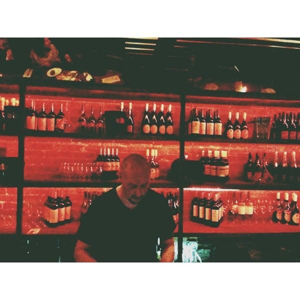 Photo taken at Custom Wine Bar by Saevar H. on 4/7/2013