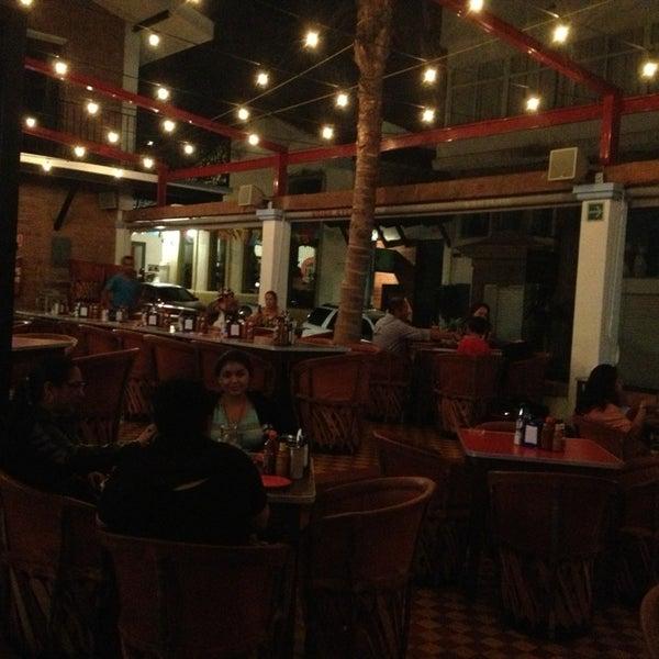 Photo taken at La Cerveceria Union by Irma I. on 2/23/2013