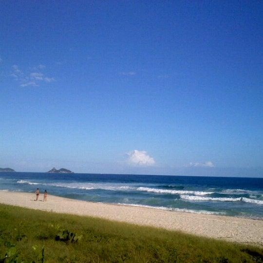 Photo taken at Praia da Barra da Tijuca by Josias J. on 3/29/2013