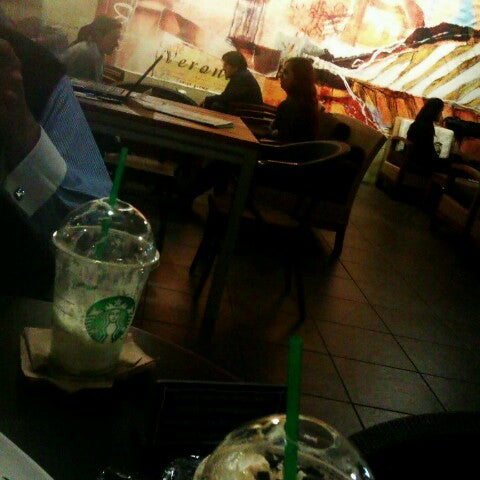 Photo taken at Starbucks by Sam C. on 1/31/2013