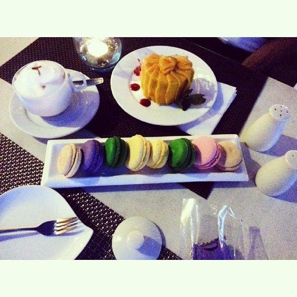 Photo taken at Sweet Bella Cafe by vivian on 1/6/2014