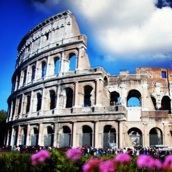 Photo taken at Piazza del Colosseo by Fabio O. on 3/21/2013