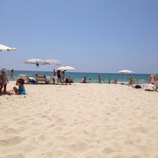 Photo taken at Praia do Barril by César S. on 7/21/2013