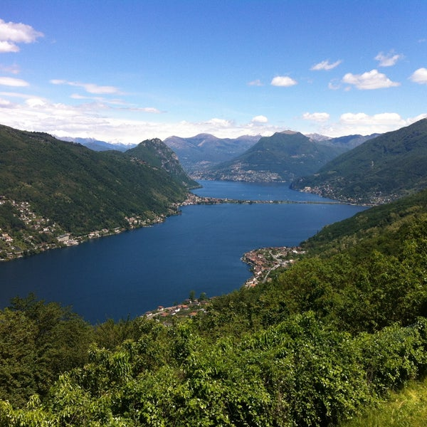 Photo taken at Lago di Lugano by Selcuk D. on 5/26/2013
