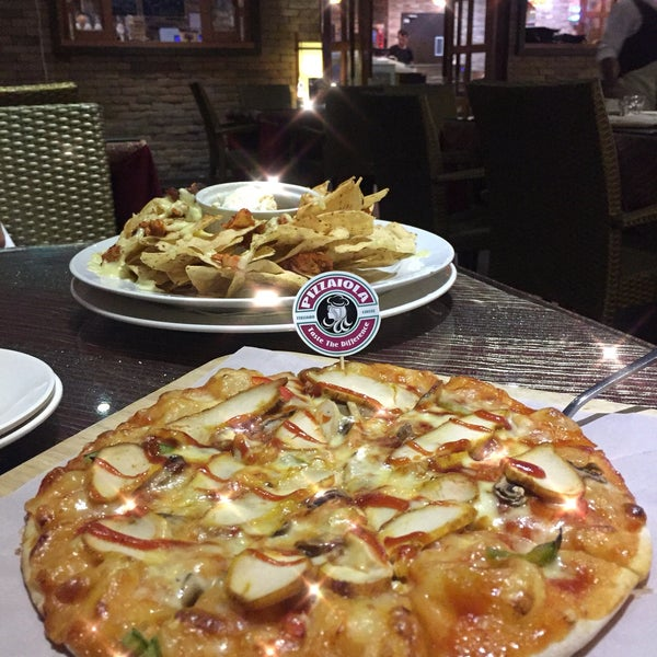 Photo taken at Pizzaiola by Cheslyn A. on 1/10/2018