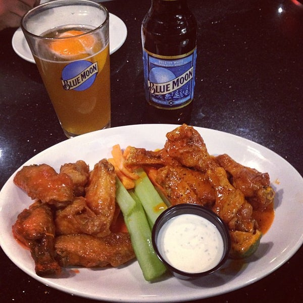 Photo taken at Alondra Hot Wings by Alma C. on 5/14/2013