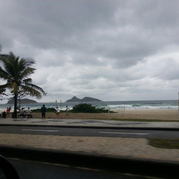 Photo taken at Praia da Barra da Tijuca by Evandro T. on 7/25/2013