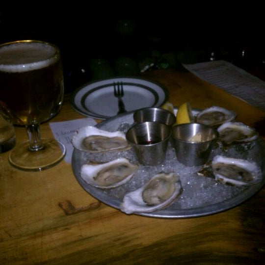 Photo taken at Upstate Craft Beer and Oyster Bar by Charlie J. on 9/26/2012
