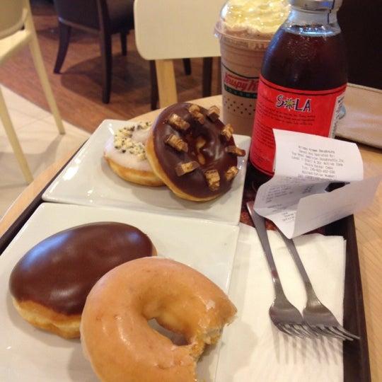 Photo taken at Krispy Kreme by Katharina M. on 10/10/2012