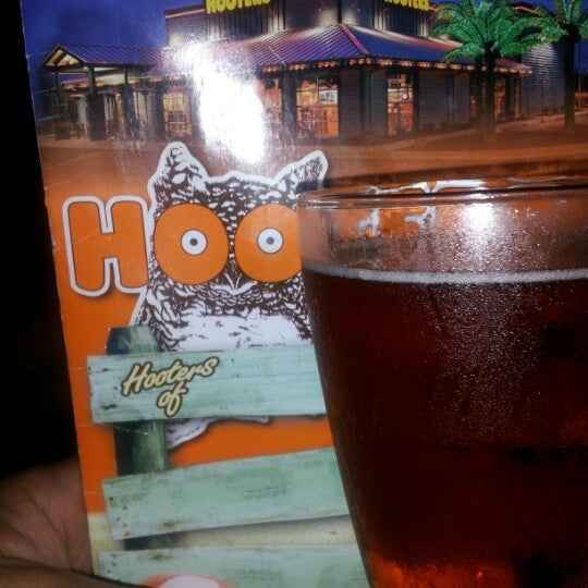Photo taken at Hooters by Marcos F. on 12/29/2012