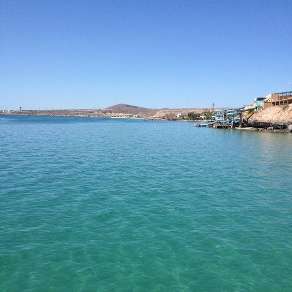Photo taken at Playa Pichilingue by Roberto I. on 4/12/2013