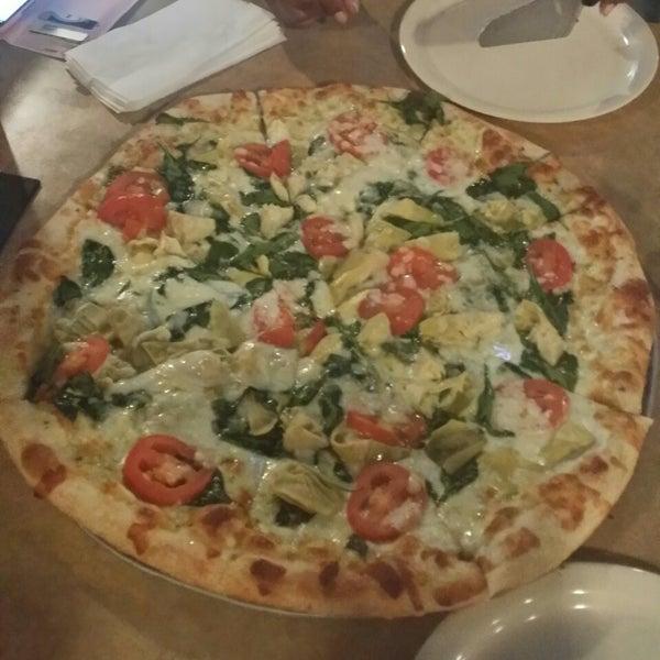 Photo taken at Stone Mountain Pizza Cafe by Amira Z. on 4/22/2014
