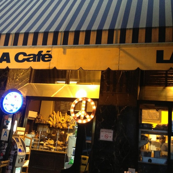 Photo taken at LA Café by Erik V. on 4/15/2013
