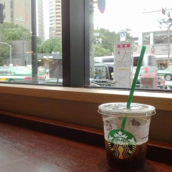 Photo taken at Starbucks by jiro on 7/24/2013