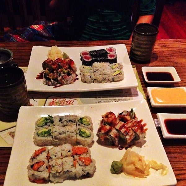 Photo taken at Tomo Japanese Cuisine by Kofi A. on 2/25/2014
