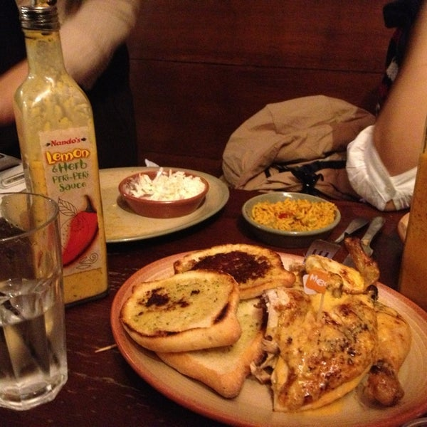 Photo taken at Nando's by Ali B. on 1/30/2013