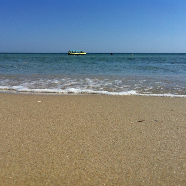 Photo taken at Ramo Beach by Sultan S. on 7/16/2013