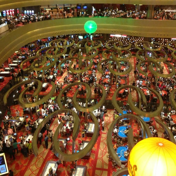 Photo taken at Marina Bay Sands Casino by KJ H. on 6/18/2013