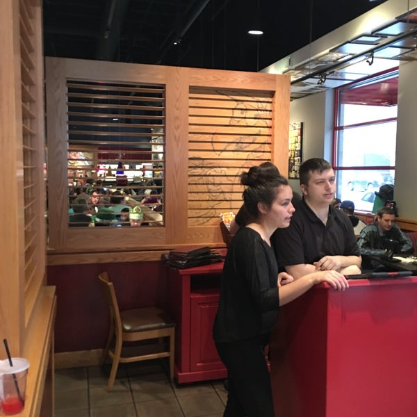 Photo taken at Red Robin Gourmet Burgers by Trevor W. on 3/12/2016