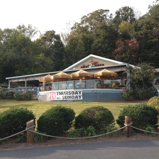 Photo taken at Fish Tales Lakeside Grille by Chris B. on 10/12/2012