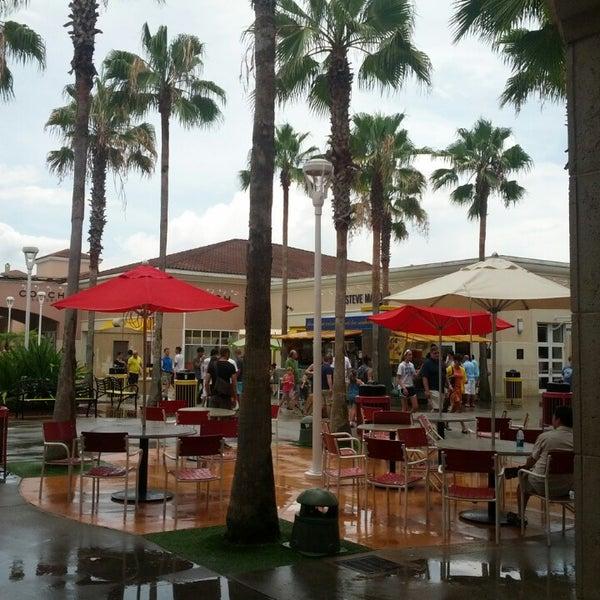 Photo taken at Orlando Vineland Premium Outlets by Gustavo B. on 6/29/2013