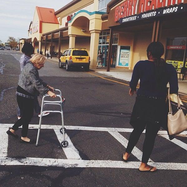 Photo taken at Walt Whitman Shops by Demetri P. on 10/10/2013