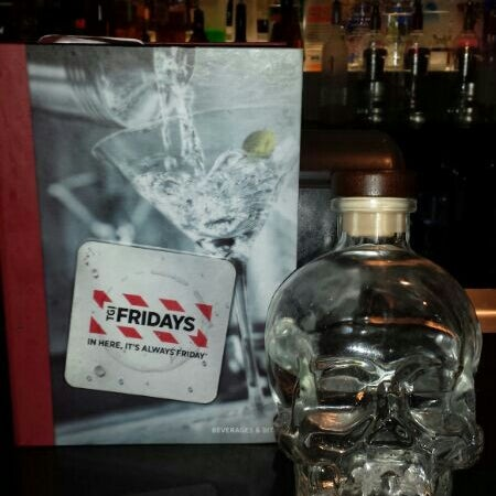 Photo taken at TGI Fridays by Manuel G. on 1/2/2014