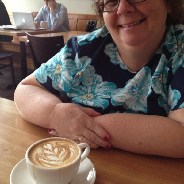Photo taken at Victrola Cafe and Roastery by Mike P. on 7/4/2013