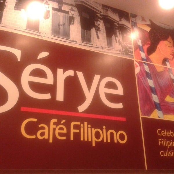 Photo taken at Sérye Café Filipino by Louise P. on 9/6/2013
