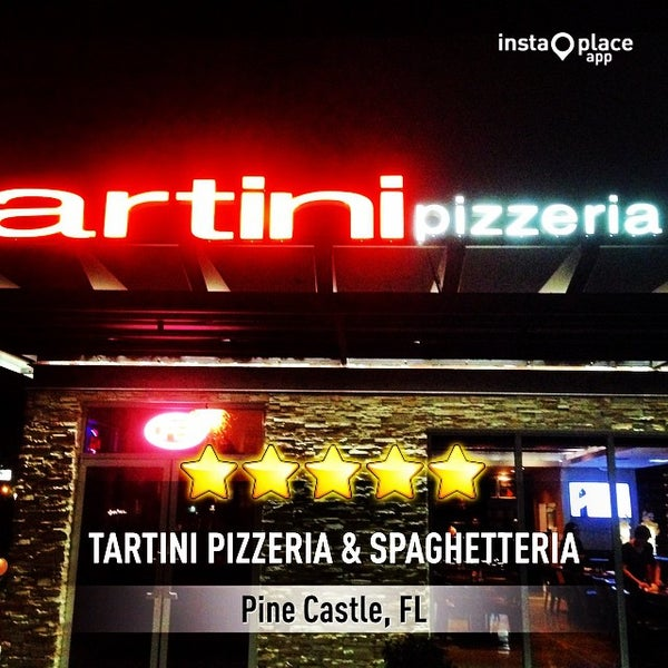 Photo taken at Tartini Pizzeria & Spaghetteria by Angel S. on 10/5/2014