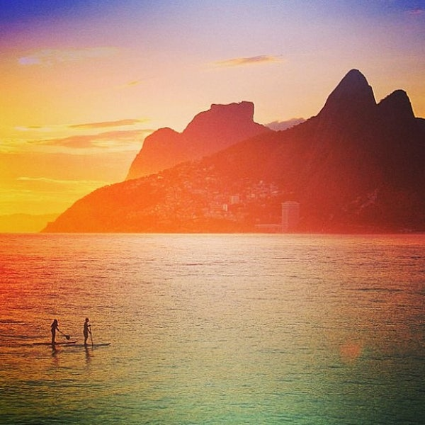 Photo taken at Ipanema Beach by Marcelo S. on 5/30/2013