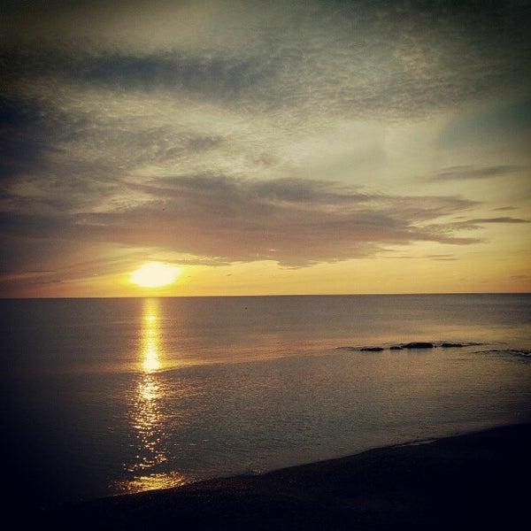 Photo taken at Aberystwyth Beach by Jonathan on 9/25/2012