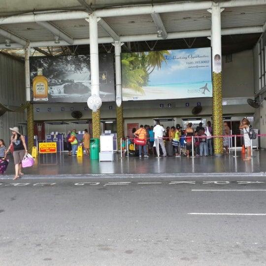 Photo taken at A.N.R. Robinson International Airport (TAB) by Berri- A. on 8/14/2013