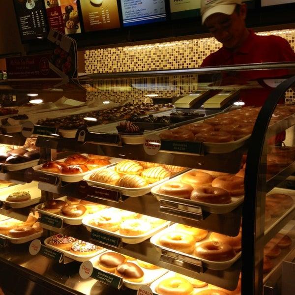 Photo taken at Krispy Kreme by Tiffany G. on 7/6/2013