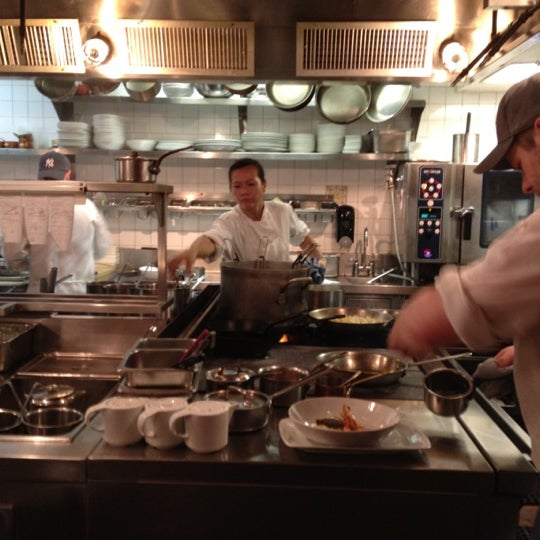 """Snag one of the 4 seats on """"the pass"""" overlooking the kitchen & watch the magic behind the incredible food."""