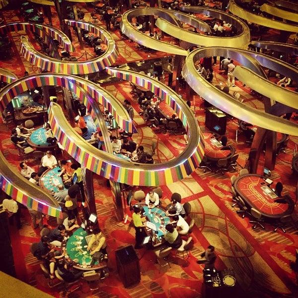Photo taken at Marina Bay Sands Casino by Екатерина Р. on 1/14/2013