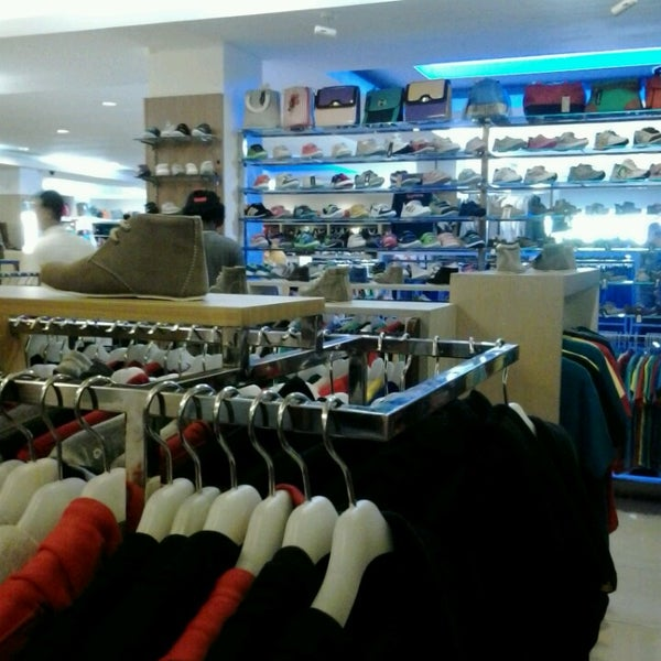 Photo taken at Outlet Biru by Chi A. on 6/4/2013