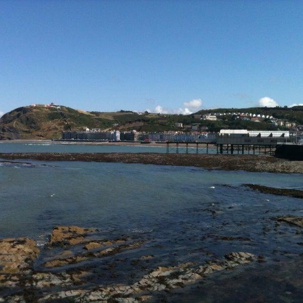 Photo taken at Aberystwyth Beach by John Paul G. on 8/3/2013