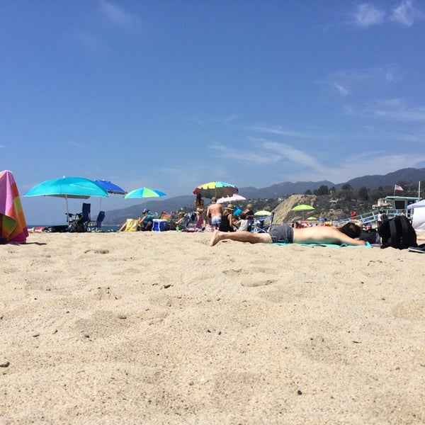 Photo taken at Pacific Palisades Beach by Alex K. on 8/31/2014