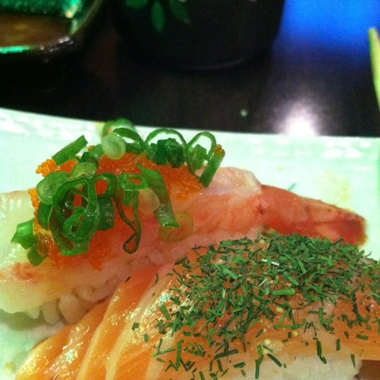 Photo taken at Rock & Roll Japanese Cuisine by Erica C. on 10/21/2012