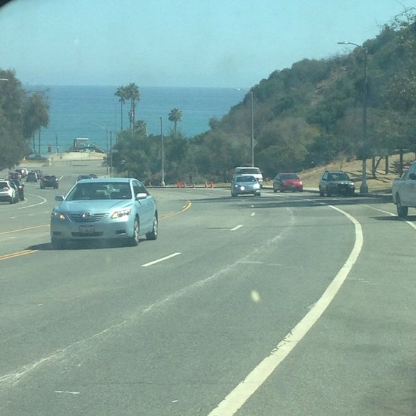 Photo taken at Pacific Palisades Beach by Paul F. on 9/11/2014