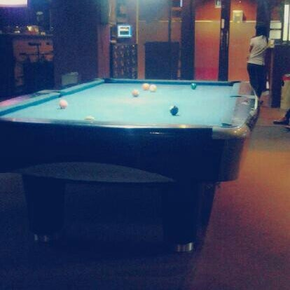 Photo taken at Rick's Cafe & Billiard by Yunizon M. on 9/18/2013