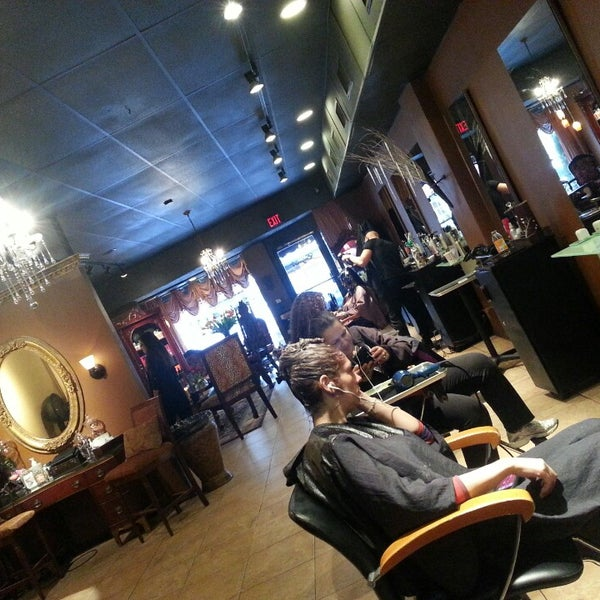 Photo taken at Enigma Hair Studio, LLC by Jeanette P. on 1/11/2014