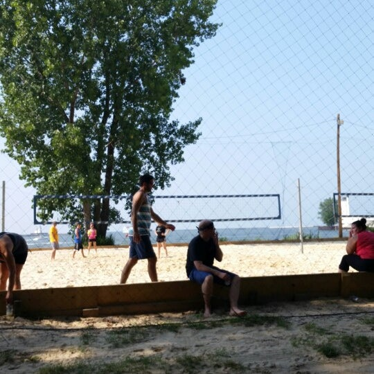 Photo taken at Whiskey Island Volleyball Courts by Nico P. on 8/3/2014