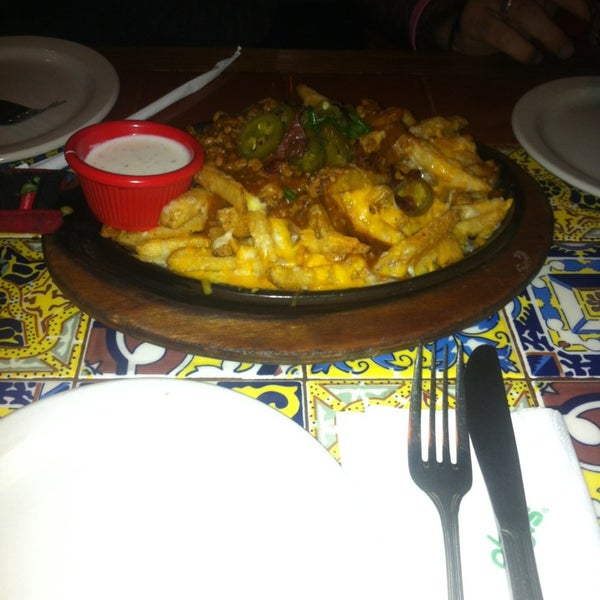 Photo taken at Chili's by Ahmed D. on 1/1/2013